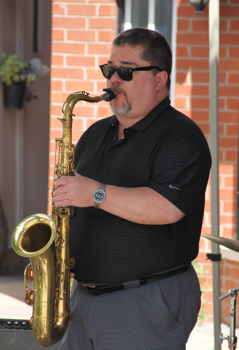 Keith Maskell playing the sax - wideshot